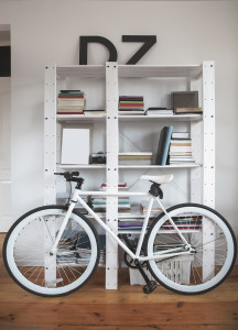 Trendy bicycle in a modern interior. Hipster bike in the interior. Road bike near the bookshelves